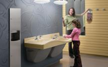 woman and girl washing hands at a Frequency multi-height lavatory system