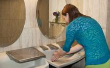girl washing her hands at 3-in-1 Advocate AV-series sink with co-located soap water and hand drying