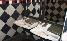 2 station 3-in-1 Advocate AV-series sink with co-located soap water and hand drying in checkered bathroom