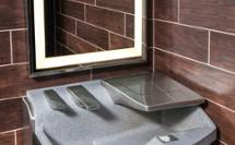 3-in-1 Advocate AV-series sink with co-located soap water and hand drying - shown as single station in a dark restroom